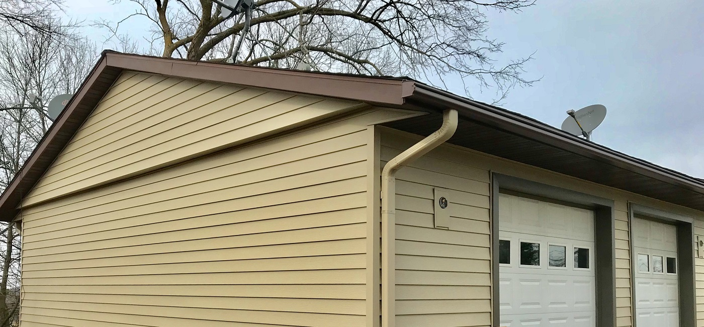 one-piece gutter guard on garage